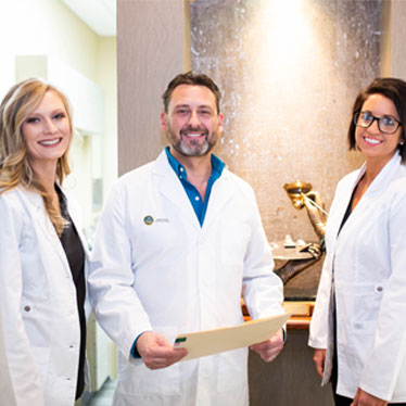 Four teachers at competitive edge dental academy